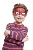 Giovane ragazzo con lo Spiderman della pittura del fronte Immagini Stock