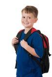 Giovane ragazzo con lo zaino su bianco Immagine Stock