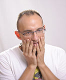 Giovane ragazzo con un'espressione del rammarico Fotografie Stock