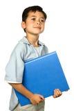 Giovane ragazzo di banco con il suo dispositivo di piegatura blu Fotografia Stock Libera da Diritti