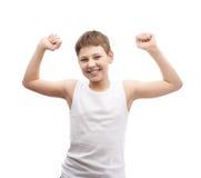 Giovane ragazzo felice in una camicia senza maniche Immagine Stock