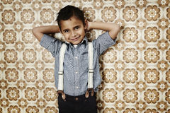 Giovane ragazzo sicuro in ganci Immagine Stock Libera da Diritti