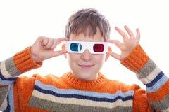 Giovane ragazzo sveglio che porta i vetri 3D Immagini Stock Libere da Diritti