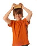 Giovane ragazzo teenager con i libri Immagini Stock