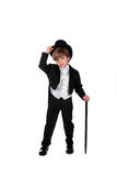 Giovane ragazzo in tux che capovolge il suo cappello Fotografia Stock Libera da Diritti