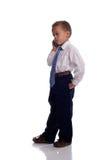 Giovane ragazzo vestito come uomo d'affari con il telefono mobile Fotografie Stock Libere da Diritti