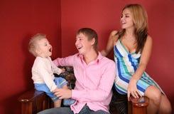 Giovane risata della famiglia Fotografie Stock