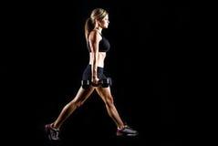 Giovane risolvere tonificato della donna di forma fisica. Fotografie Stock