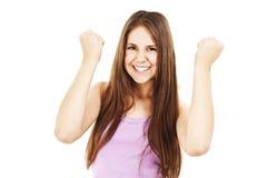 Giovane riuscita donna nella celebrazione allegra. Immagine Stock