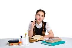 Giovane scolara che fa gli esercizi Fotografie Stock