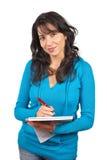 Giovane scrittura della donna dell'allievo Fotografie Stock