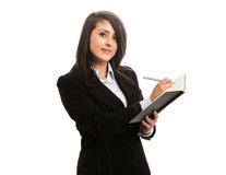 Giovane scrittura della donna di affari in taccuino Fotografia Stock Libera da Diritti