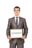 Giovane segno felice del vincitore della tenuta dell'uomo d'affari Immagine Stock