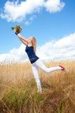 Giovane signora con i fiori Fotografie Stock Libere da Diritti