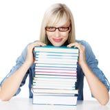 Giovane signora con la pila di libri Immagine Stock Libera da Diritti