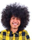 Giovane sorridente con capelli lunghi immagine stock