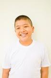 Giovane sorridere asiatico del ragazzo Immagine Stock