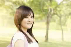 Giovane sorridere asiatico della studentessa Immagini Stock