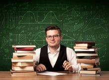 Giovane spiegazione dell'insegnante Immagini Stock Libere da Diritti