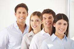 Giovane squadra di affari in una riga Fotografia Stock