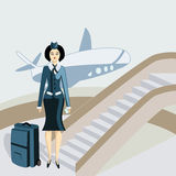 Giovane stewardess con una valigia Immagine Stock