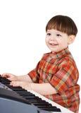 Giovane stu del bambino per giocare musica Immagini Stock