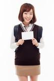 Giovane studente asiatico che mostra carta vuota Fotografie Stock