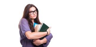 Giovane studente attraente con i lotti dei libri Fotografie Stock Libere da Diritti