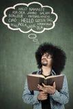 Giovane studente che pensa lingua straniera Fotografie Stock