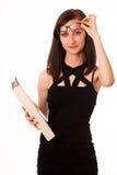 Giovane studente con una cartella in sue mani Fotografia Stock