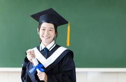 Giovane studente di graduazione nella sua aula Fotografie Stock