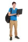 Giovane studente maschio con il computer portatile Fotografie Stock
