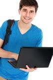 Giovane studente maschio con il computer portatile Immagine Stock Libera da Diritti