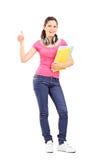 Giovane studentessa che dà pollice su Fotografia Stock Libera da Diritti