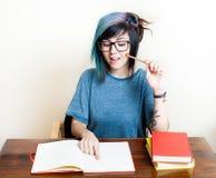 Giovane studentessa felice con i libri Fotografia Stock