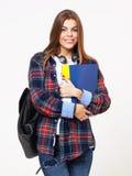 Giovane studentessa felice con i libri isolati sul backgrou bianco Fotografie Stock Libere da Diritti