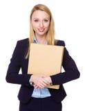 Giovane tenuta della donna di affari con la cartella Immagine Stock Libera da Diritti
