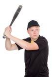 Giovane tipo che si prepara per colpire il pipistrello Immagine Stock