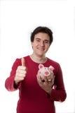 Giovane tirante felice con la banca piggy Fotografia Stock Libera da Diritti