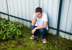 Giovane triste Fotografie Stock Libere da Diritti