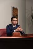 Giovane ufficio bello di Portrait In His dell'uomo d'affari Fotografia Stock