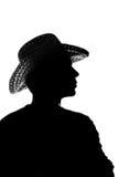 Giovane in un cappello di paglia - siluetta Fotografia Stock