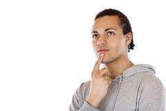 Giovane uomo africano che sembra alto contemplativo Immagini Stock