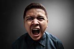 Giovane uomo arrabbiato fotografia stock libera da diritti