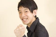 Giovane uomo asiatico che fa lotta Immagini Stock