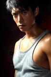 Giovane uomo asiatico che suda Fotografie Stock Libere da Diritti