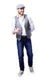 Giovane uomo bello che posa e che dà un pollice su Fotografia Stock