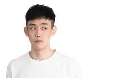 Giovane uomo bello dell'Asia - isolato sopra un fondo bianco Immagini Stock