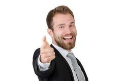 Giovane uomo bello di affari che indica a voi ed a sorridere Fotografie Stock