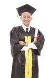 giovane uomo bello di graduazione con sorridere armcrossed mentre tenuta Fotografia Stock